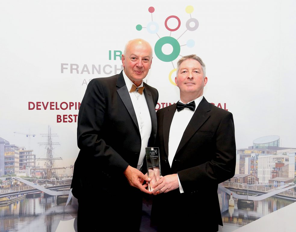 NewsTalk's Bobby Kerr awarding Dermot Keenan of AIL Group the 'Best Franchise System & Business Practice 2018' award.